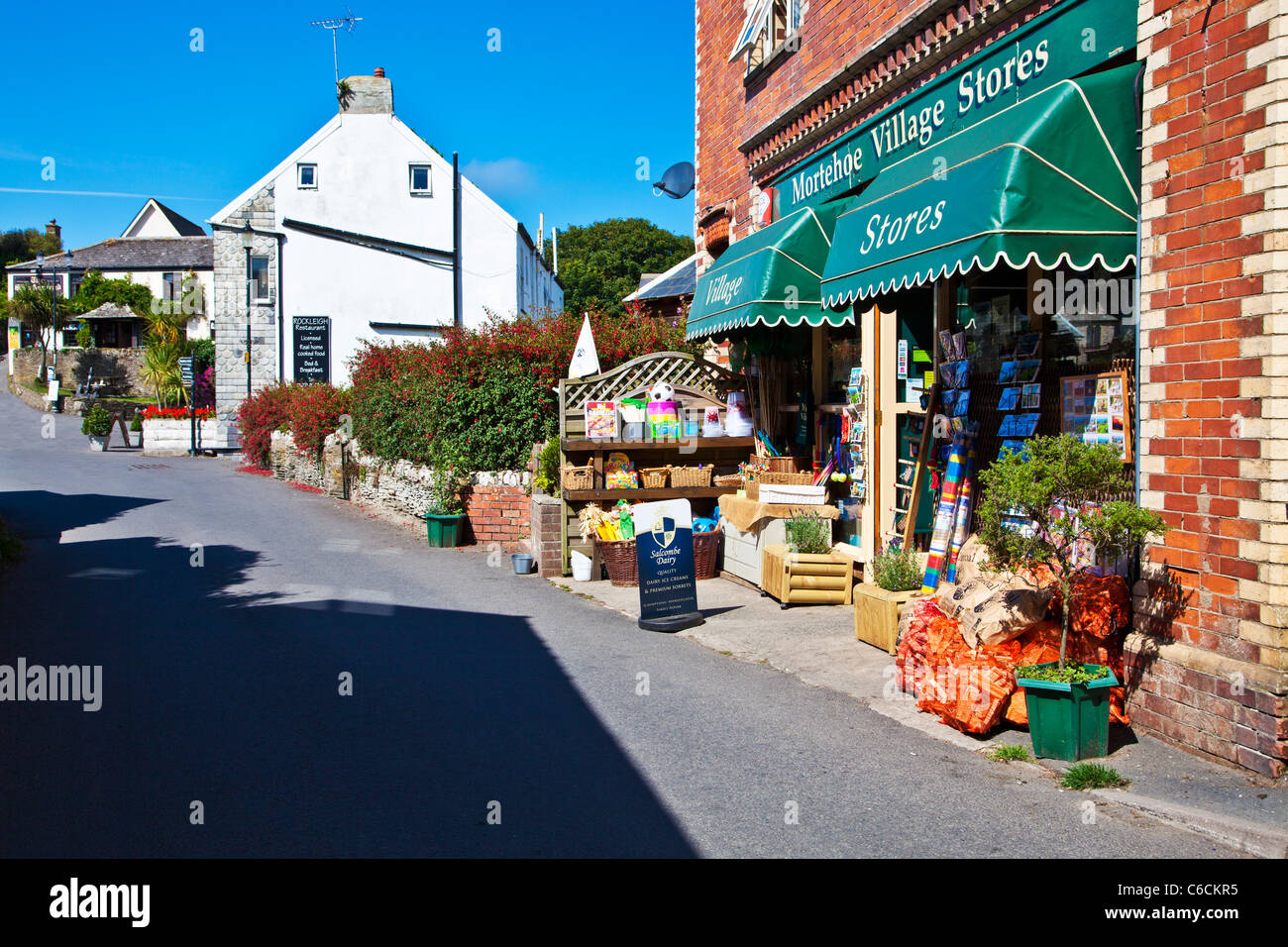 The main street through the pretty village of Morthoe near Woolacombe in north Devon, England, UK - Stock Image