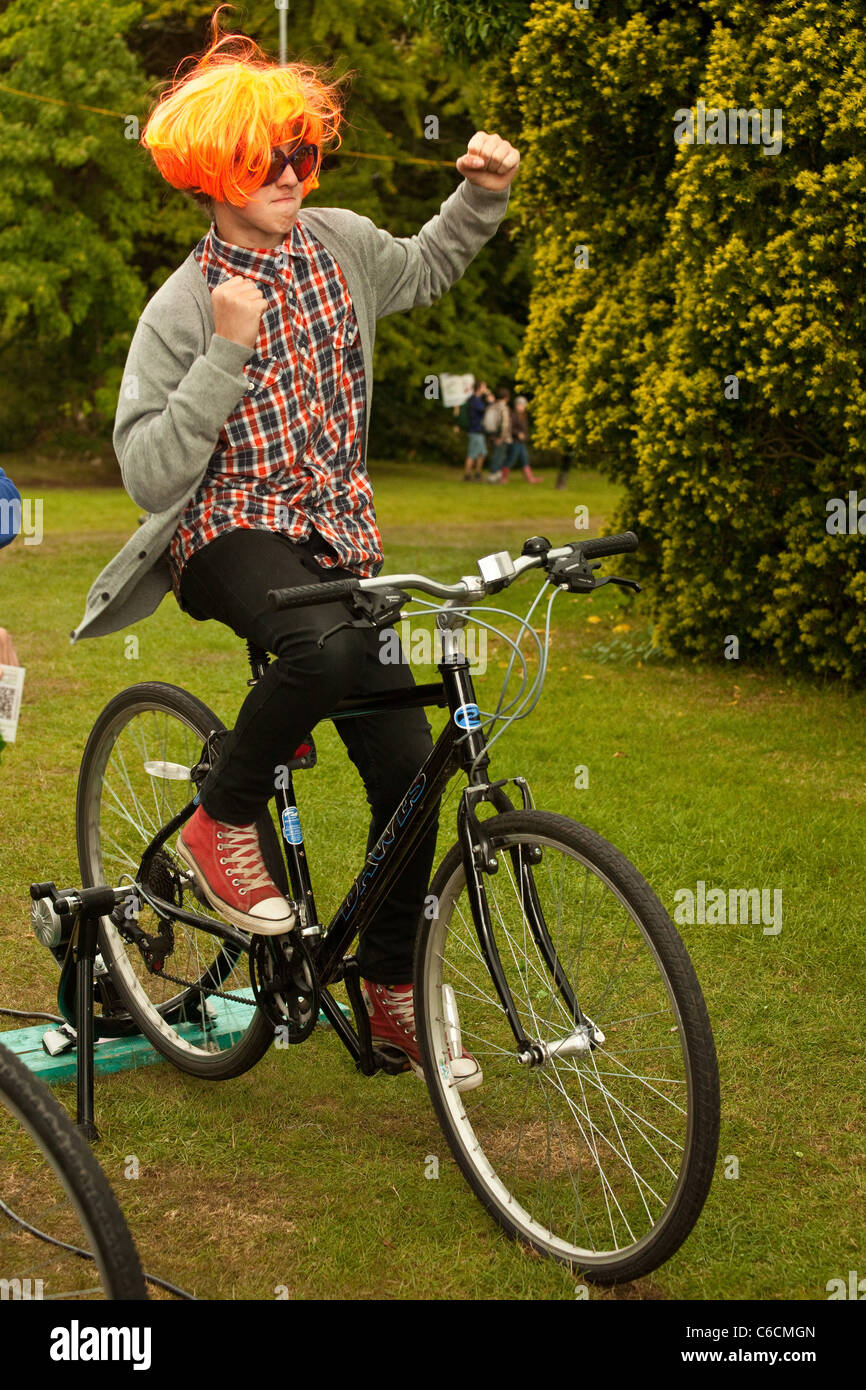 Sustrans bike phone recharge stall at the Green Man Festival 2011, Crickhowell, Mid Wales ,UK - Stock Image