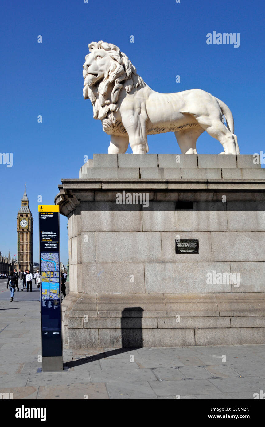 London street scene Lion Coade stone sculpture beside modern legible street signpost at Lambeth end of Westminster - Stock Image
