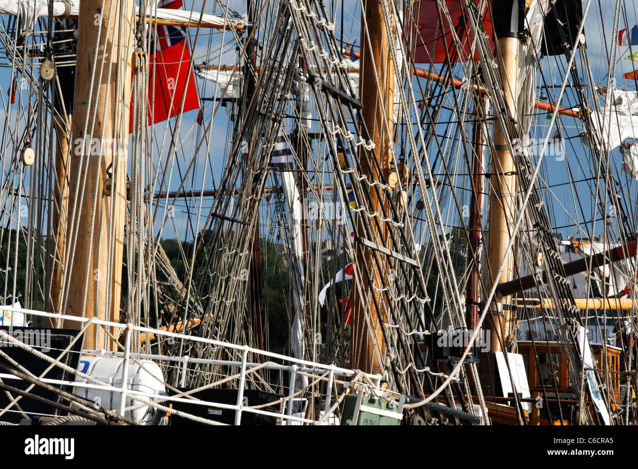 Masts and rigging of tall ships berthed at Douarnenez, meeting of traditional wooden boats (Finistère, Brittany, - Stock Image