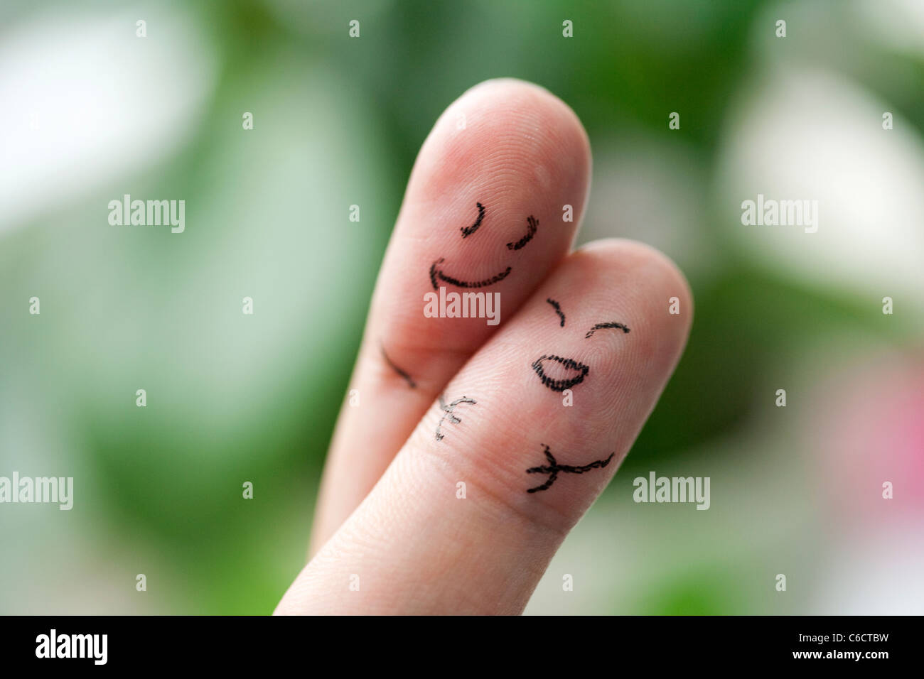 Fingers with smiling faces - Stock Image