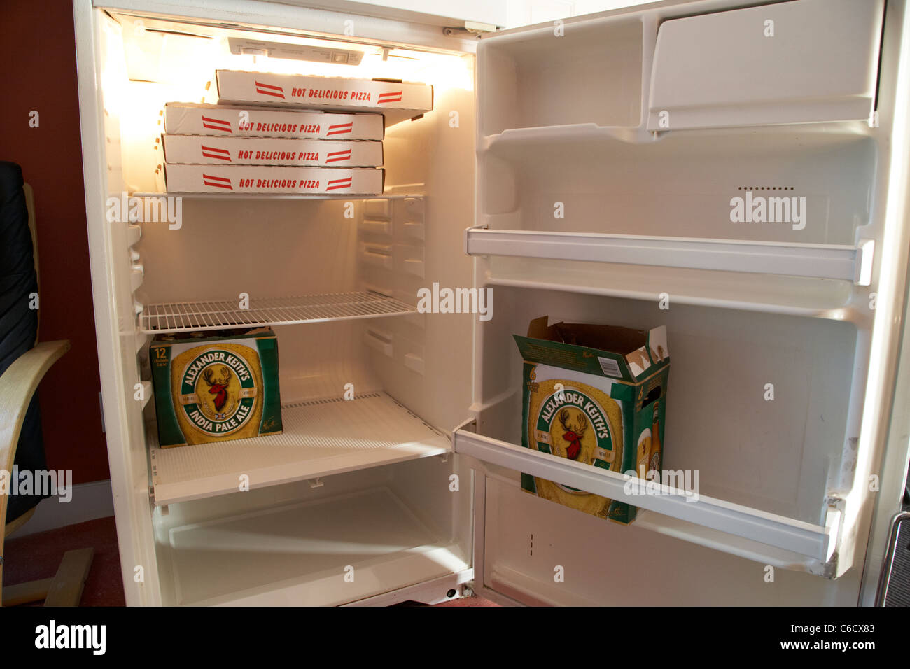 beer and pizza in a fridge winnipeg manitoba canada - Stock Image