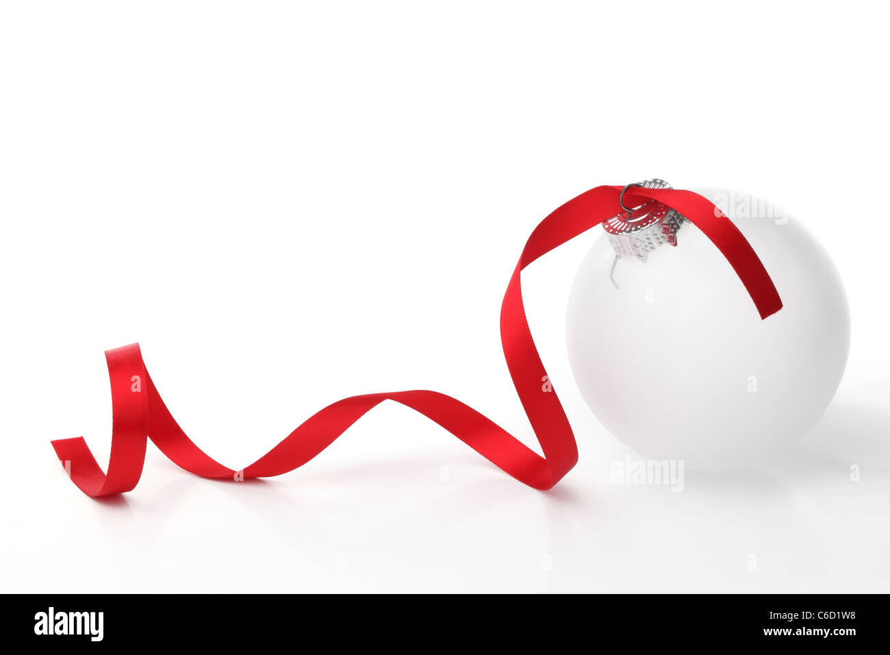 White christmas ball with ribbon on white background. - Stock Image