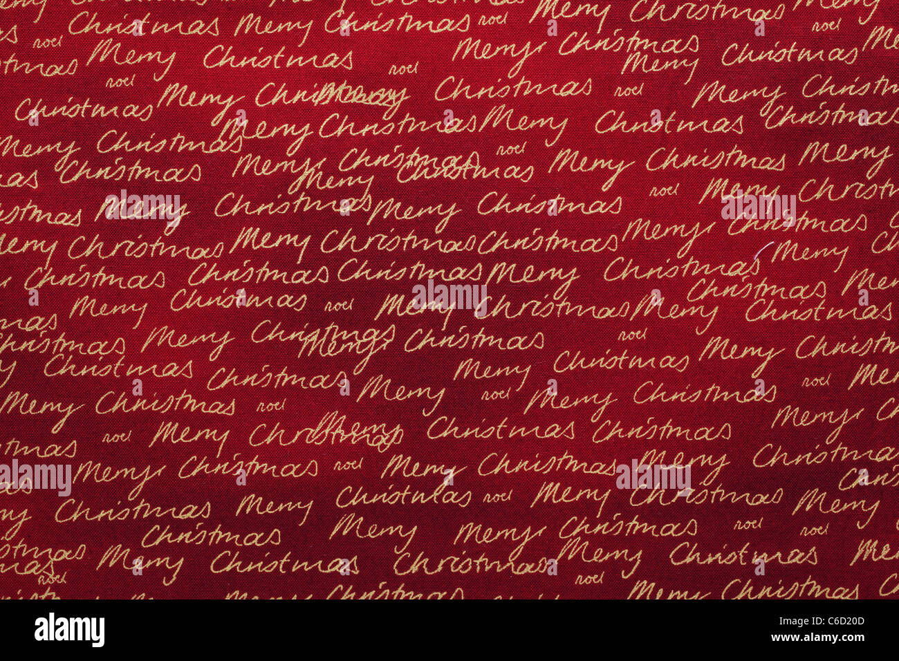 Golden Merry Christmas pattern fabric background. - Stock Image