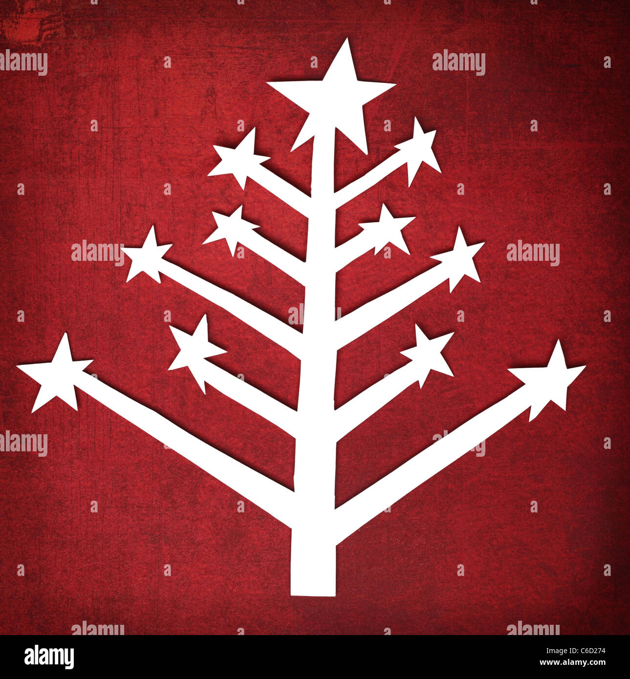 Paper Christmas tree over grunge texture background - Stock Image