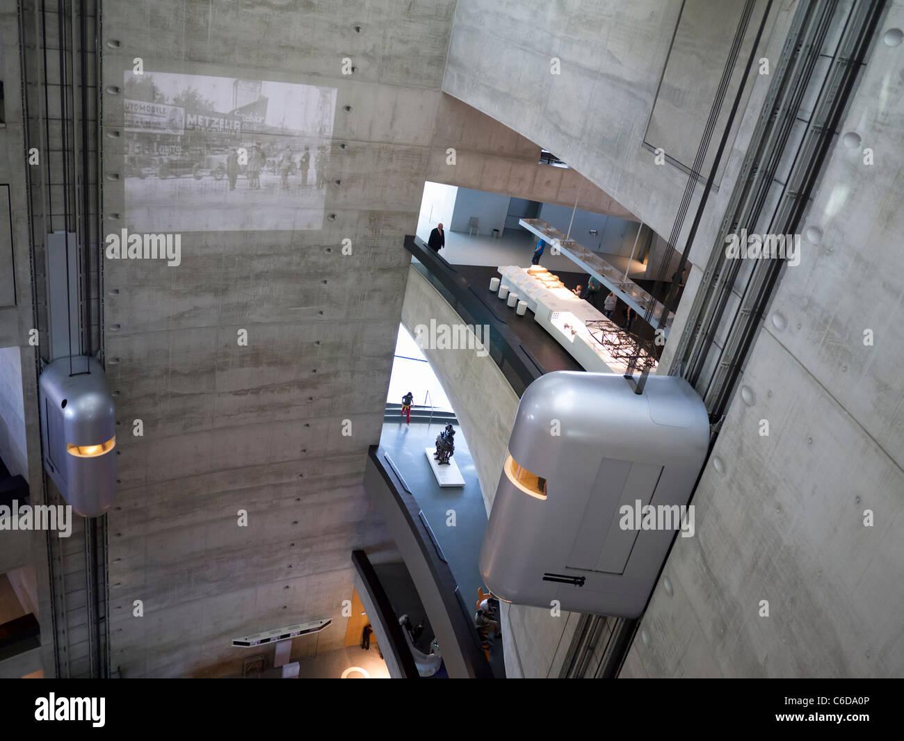 Atrium with elevators inside Mercedes Benz Museum in Stuttgart Germany - Stock Image
