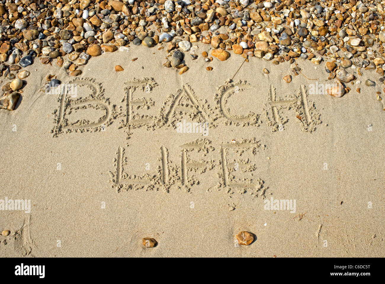 beach life written in the sand - Stock Image