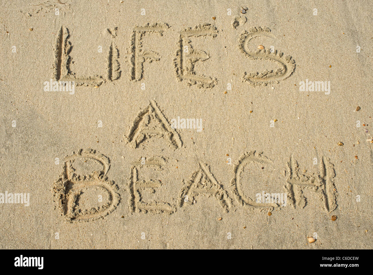Life's a beach message written in the sand - Stock Image