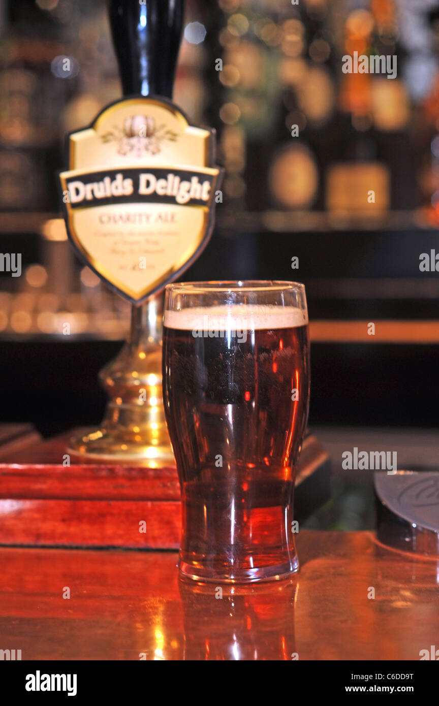 A pint of Druids Delight a beer sold at the Druids Head pub in Brighton where the profits go to local charities - Stock Image