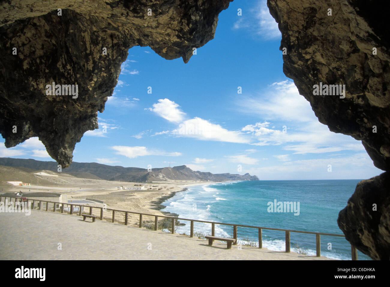Marnif Hoehle bei der, Al Mughsayl Bay, Salalah, Al Mughsayl Bay, volcanic rock, cave, bay, beach, Salalah - Stock Image