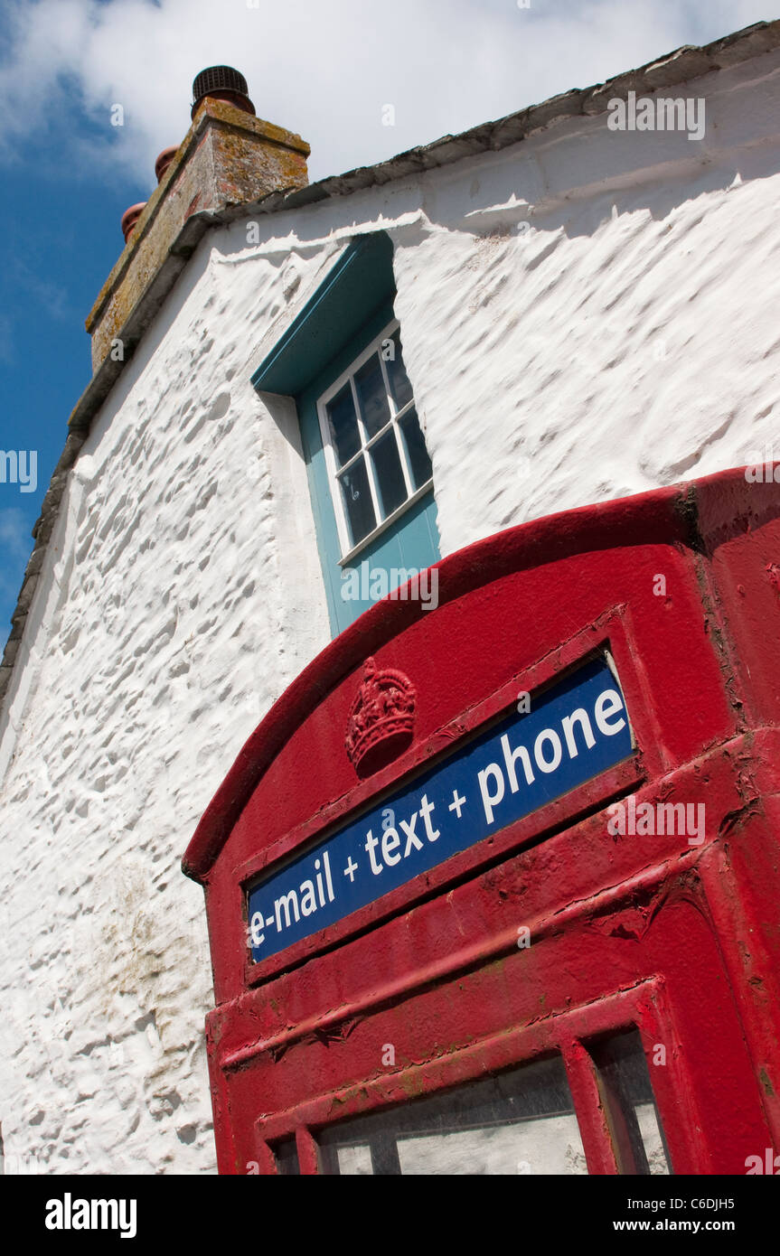 Traditional English red telephone box which can now also be used to send emails and texts. - Stock Image