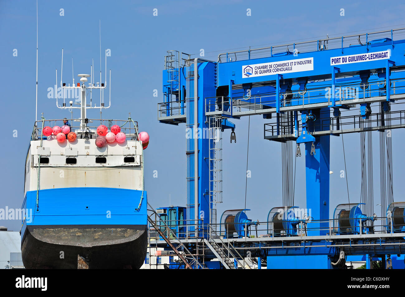 Blue trawler fishing boat on shipbuilding yard for maintenance works in the Guilvinec port, Brittany, France - Stock Image