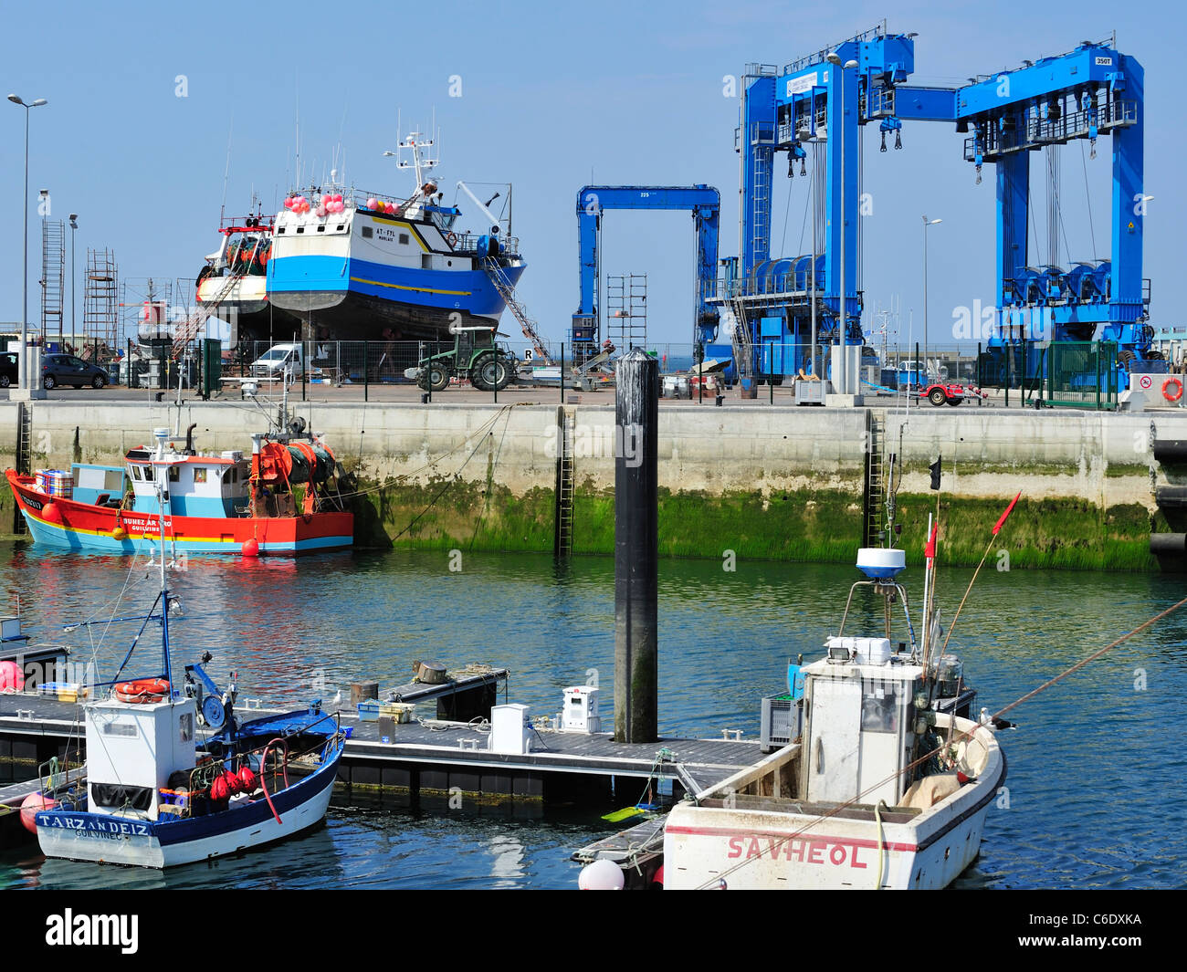 Trawler fishing boats on shipbuilding yard for maintenance works in the Guilvinec port, Brittany, France - Stock Image