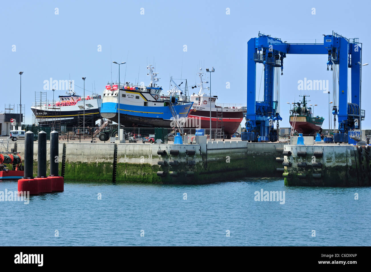 Trawler fishing boats on shipbuilding yard for maintenance works in the Guilvinec harbour, Brittany, France - Stock Image