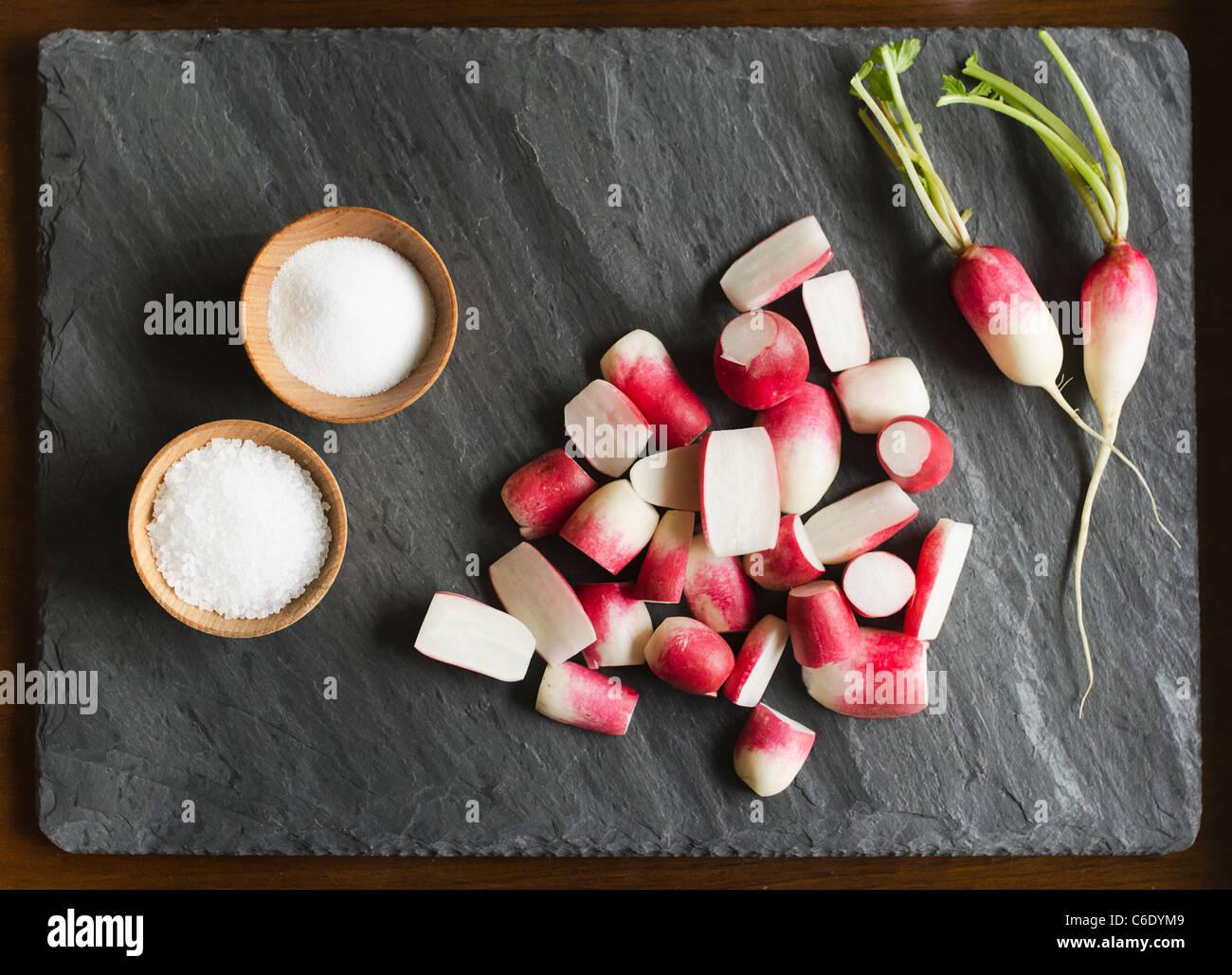 Fresh radishes with salt Stock Photo