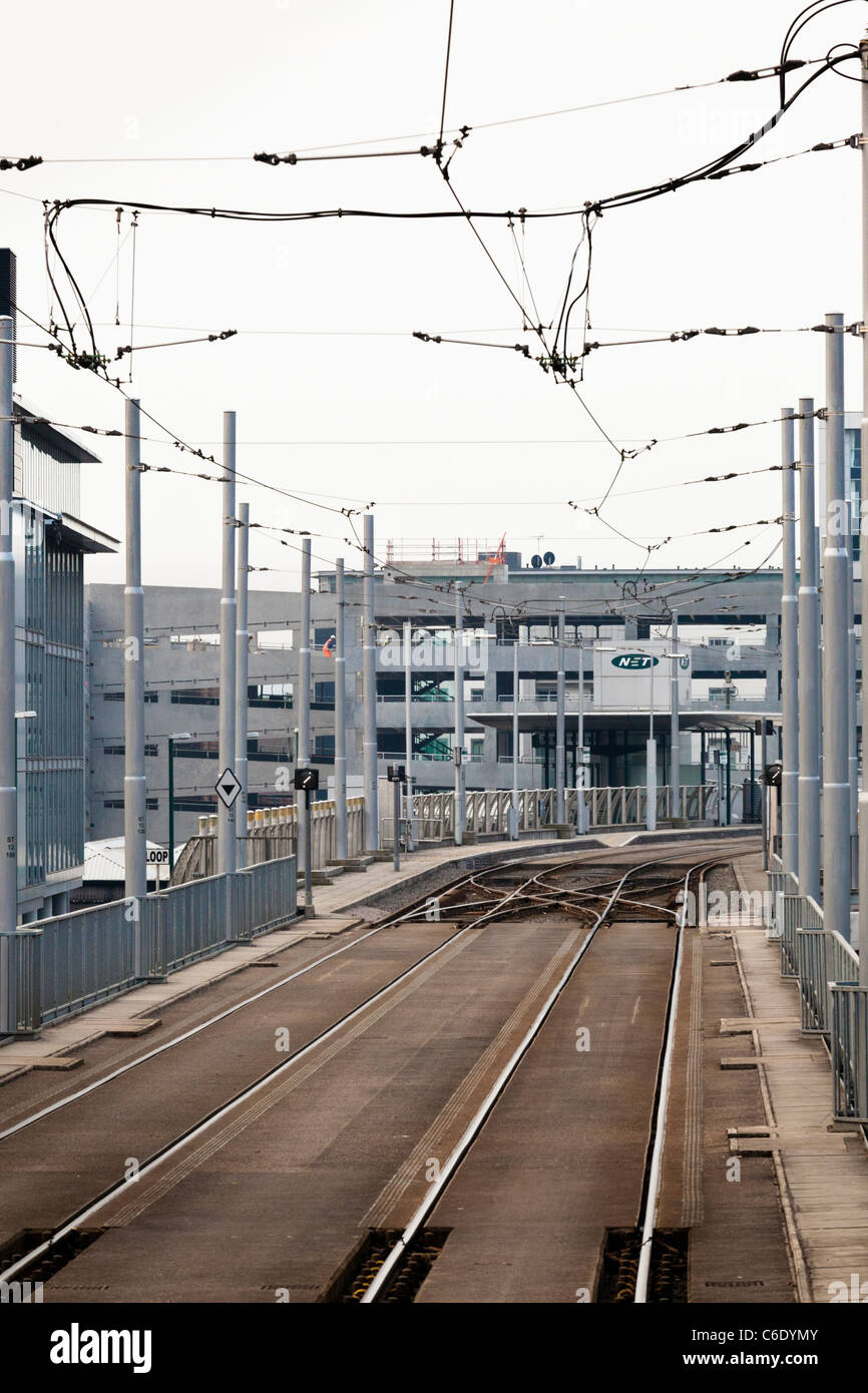 Tramlines and overhead catenary on the approach to Station Street tram stop in Nottingham, England, UK Stock Photo