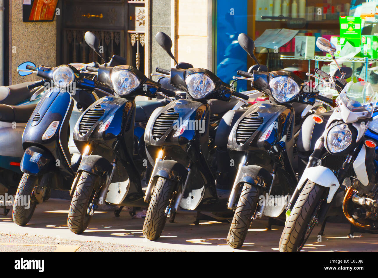 Motor bikes parked in Malaga, Malaga Province, Spain. - Stock Image