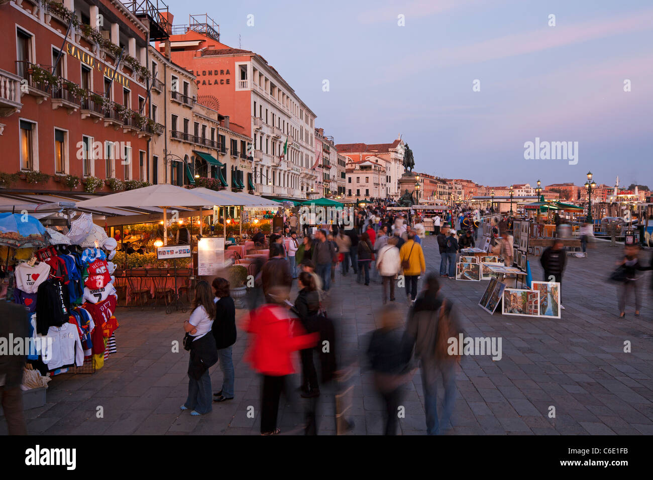 Restaurants and Cafes at dusk alongside the Grand Canal near St Marks Square, Venice, Italy - Stock Image