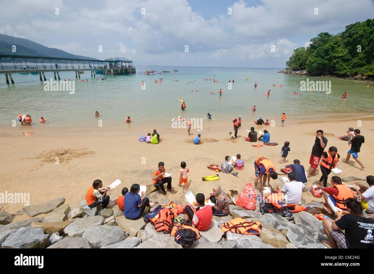 Tourists snorkeling on the beach of the Marine Park, Pulau Tioman Island, Malaysia, Southeast Asia, Asia - Stock Image