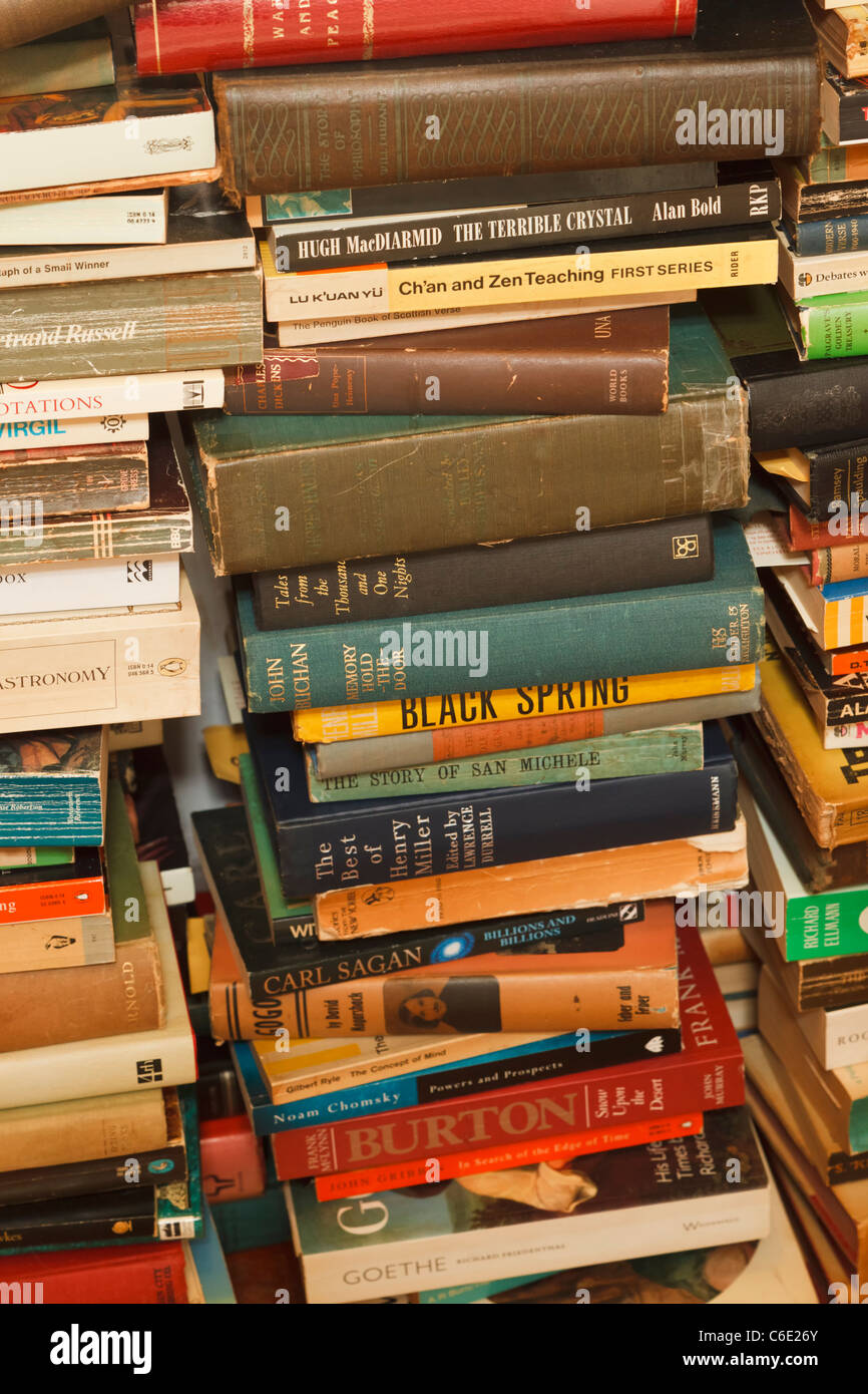 Stacks of secondhand books on many different subjects. - Stock Image