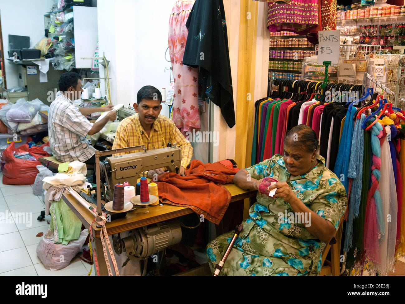48f49c9021 Clothes makers in an Indian clothes shop, the indoor Tekka market, Little  India,