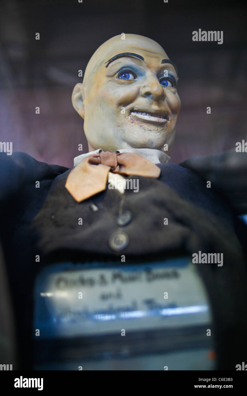 Old bald man doll arcade toy fortune teller. - Stock Image