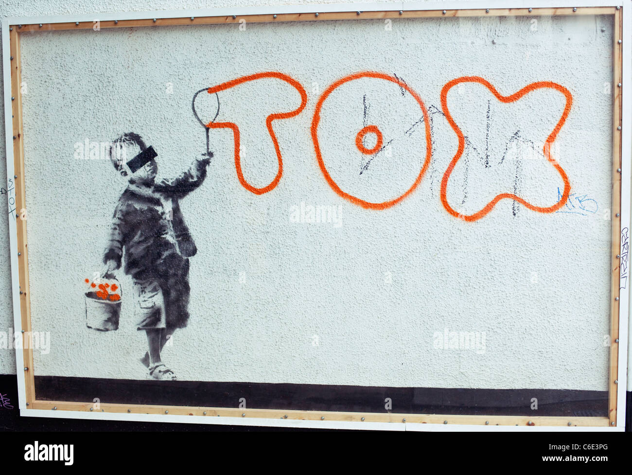 Stencil graffiti on a white wall, Camden, London, England, UK, GB - Stock Image