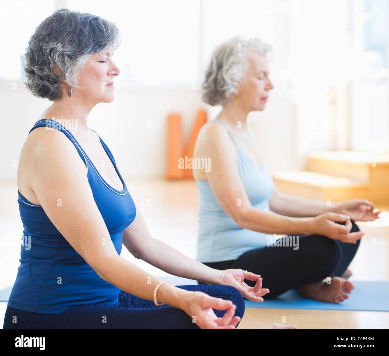 USA, New Jersey, Jersey City, Two senior women practicing yoga - Stock Image