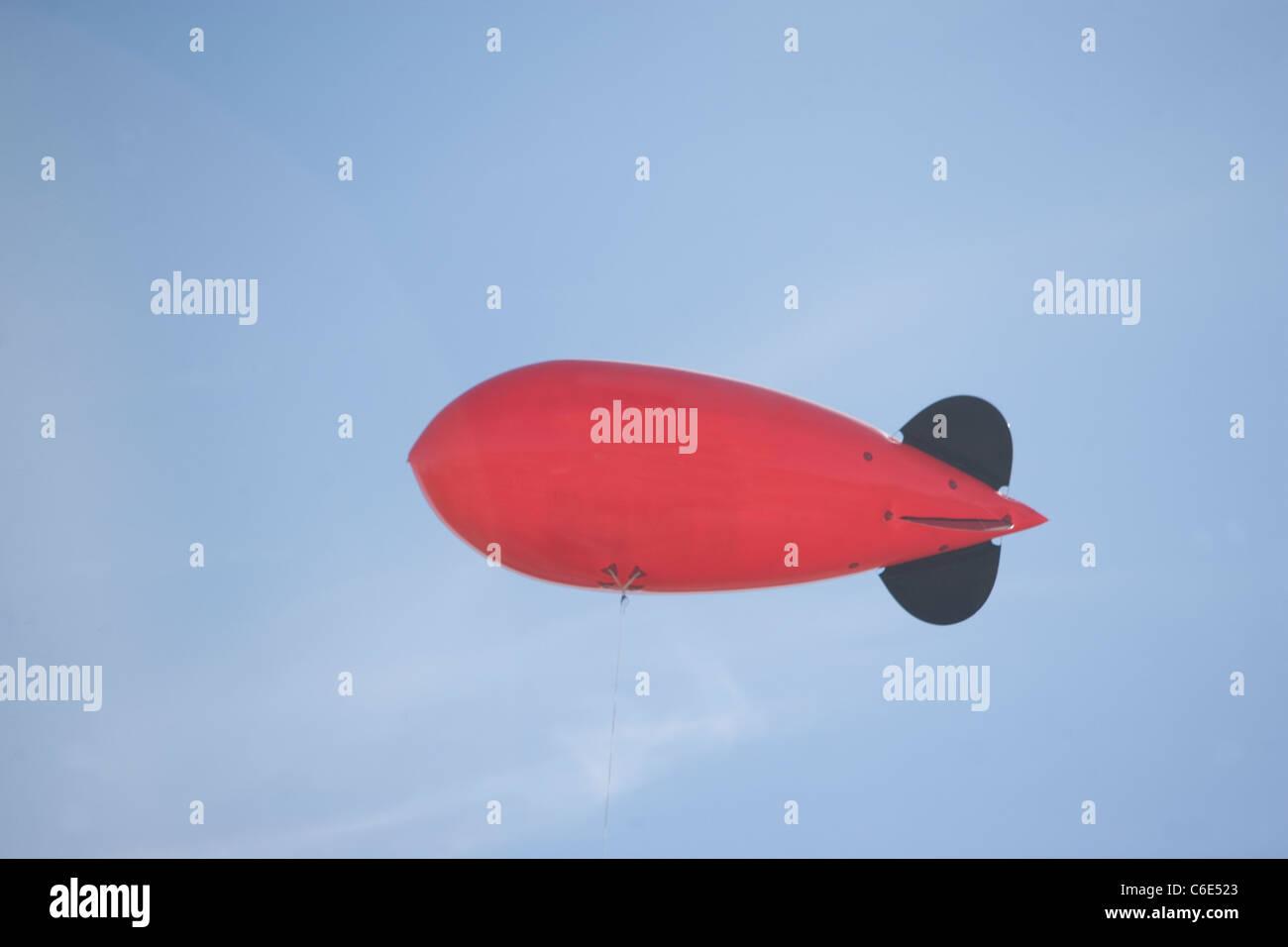 USA, New York State, New York City, flying advertising blimp - Stock Image