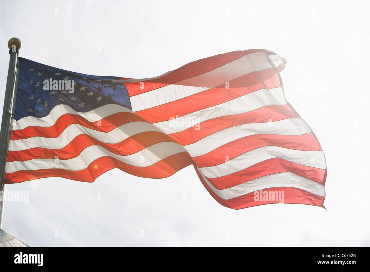 USA, New York State, New York City, American flag against sky - Stock Image