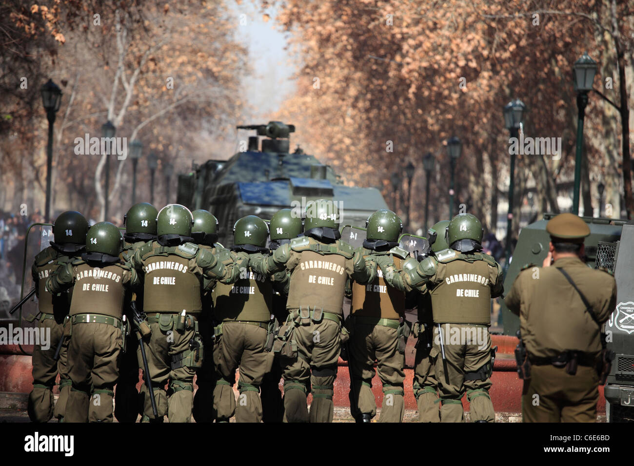 Chilean riot police watching demonstrators during a student strike in Santiago's Downtown, Chile. - Stock Image
