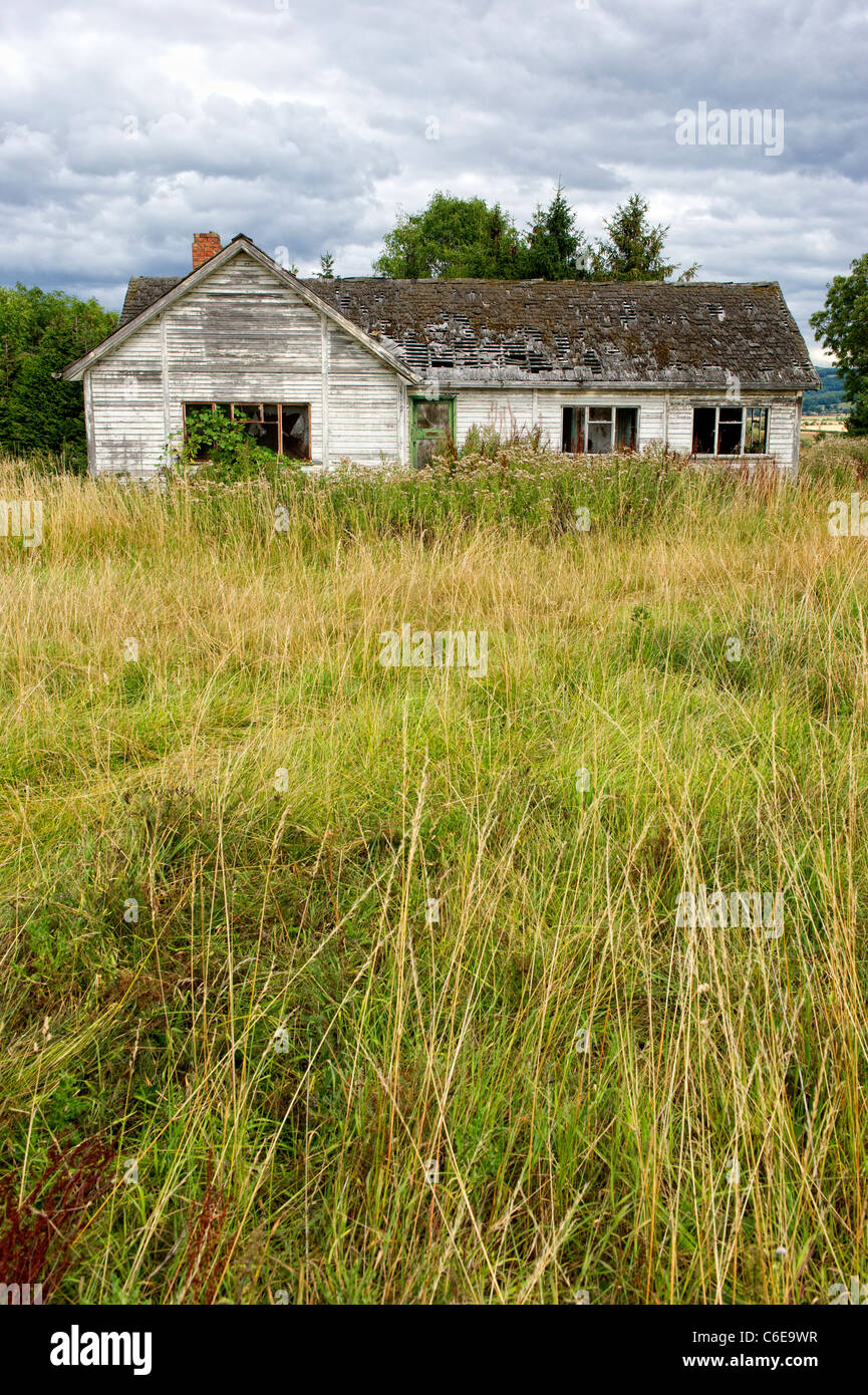 Old dilapidated building on scrub land near Winchcombe in The Cotswolds, Gloucestershire, England - Stock Image