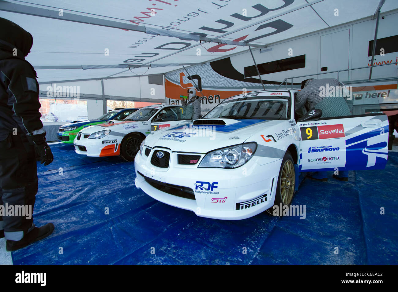 Driver and co-driver making final checkups before the rally - Stock Image
