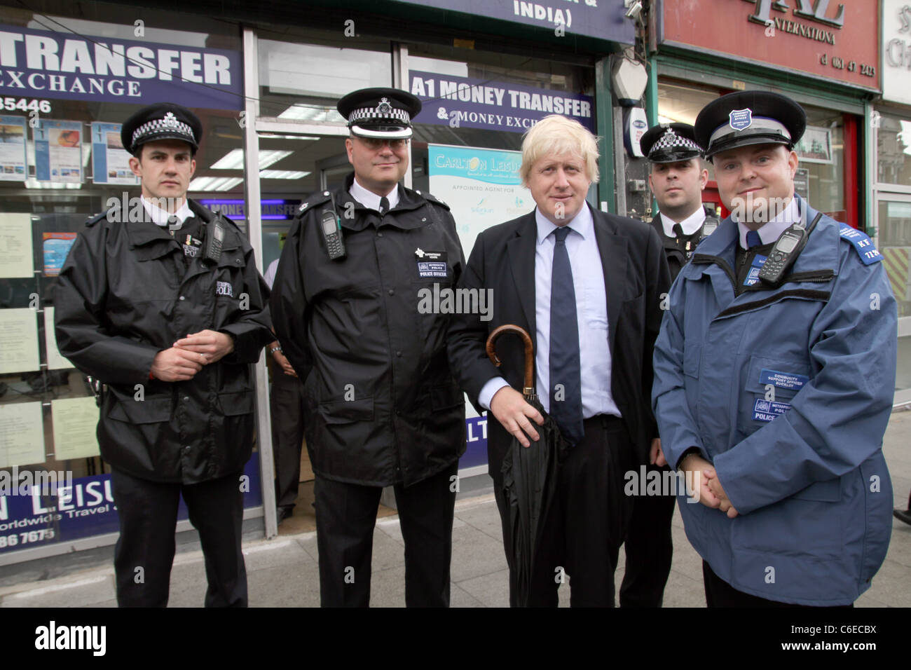 London Mayor Boris Johnson with Metropolitan Police by shops and businesses damaged by recent riots in East Ham,Newham,London - Stock Image