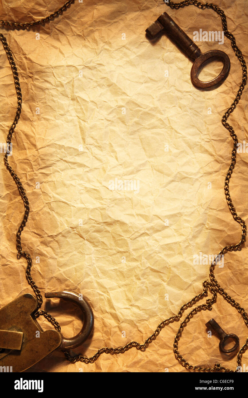 Blank sheet of crumpled paper, framed in vintage padlock and keys - Stock Image
