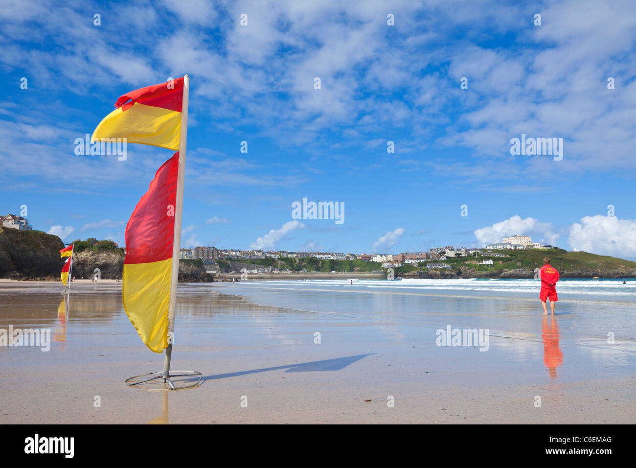Lifeguard on duty warning flags yellow and red on newquay beaches Cornwall England UK GB EU Europe - Stock Image