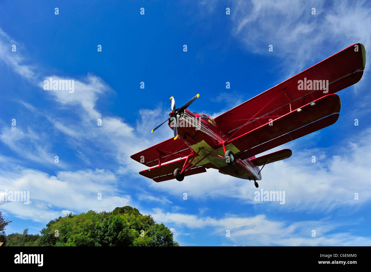 A wide angle shot of an Antonov AN-2 biplane on short finals. Motion blur on the propeller. Space for text in the - Stock Image