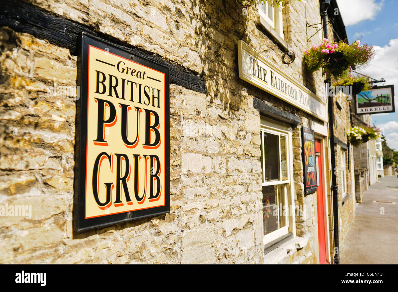 Sign outside a pub in Fairford advertising Great British Pub Grub - Stock Image