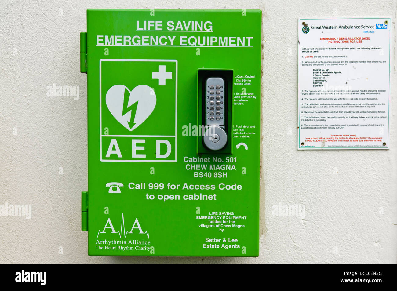 Automated External Defibrillator in a locked cabinet in a public area - Stock Image