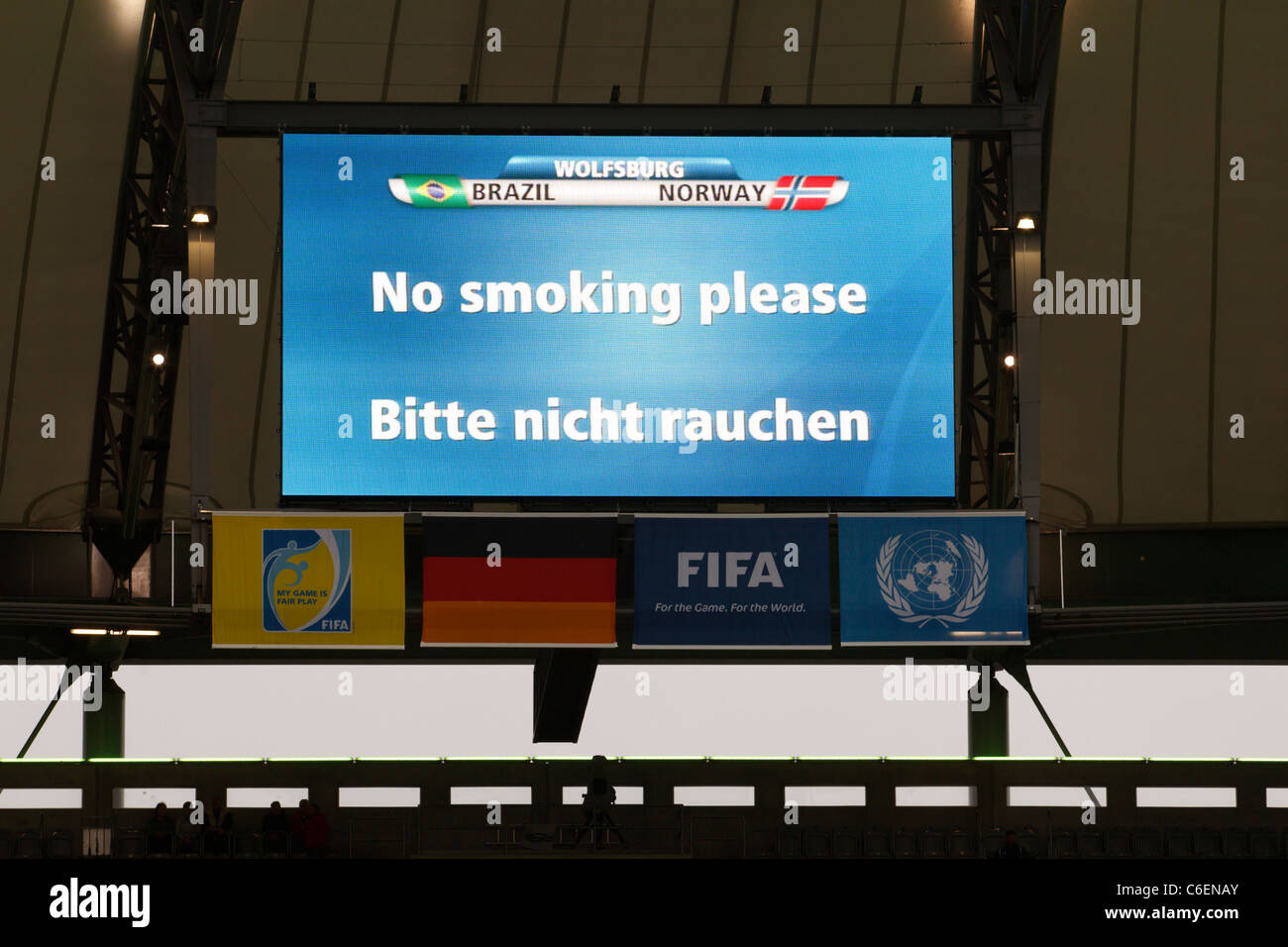 A video display indicates No Smoking at a 2011 Women's World Cup soccer match at Arena Im Allerpark in Wolfsburg, - Stock Image