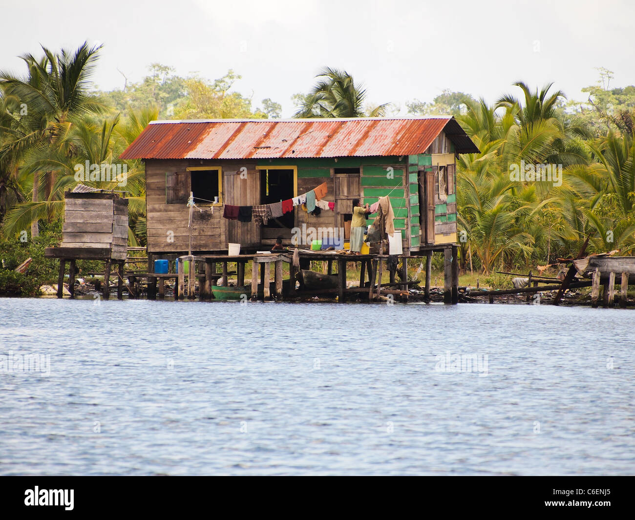 Amerindian native home over the water in Bocas Del Toro - Stock Image