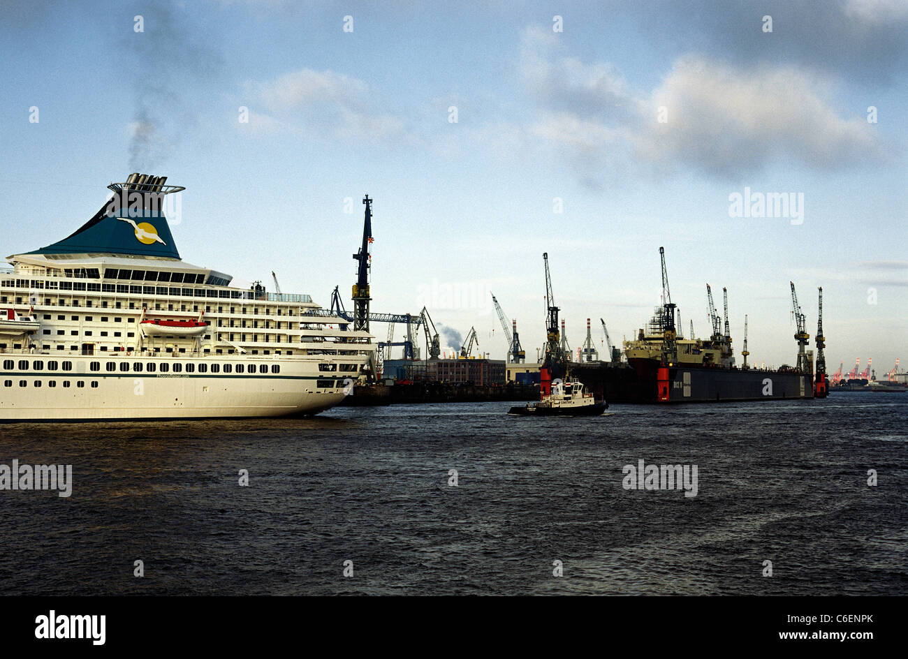 Cruise ship MS Artania passes Blohm+Voss shipyard in the port of Hamburg on her first day in service for German - Stock Image
