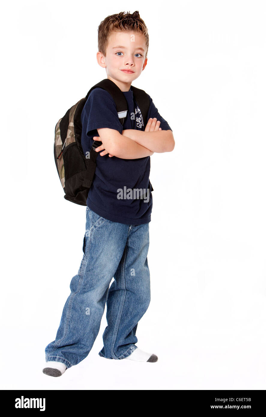 dbc676ee248b Young boy with backpack isolated on white background Stock Photo ...