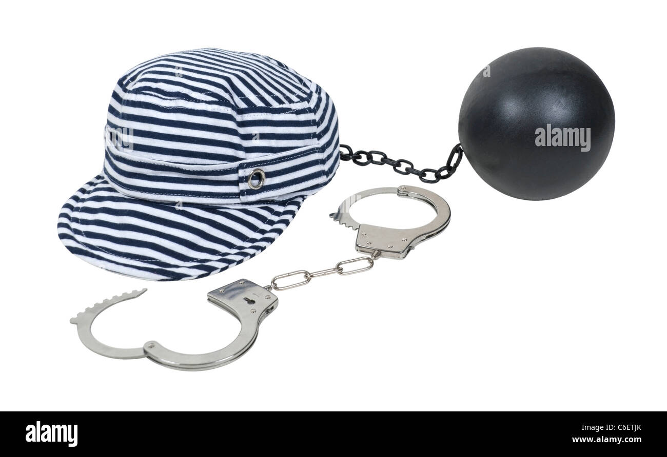 Jailbird striped hat worn in vintage jails as part of the uniform with a pair of handcuffs and ball and chain - Stock Image