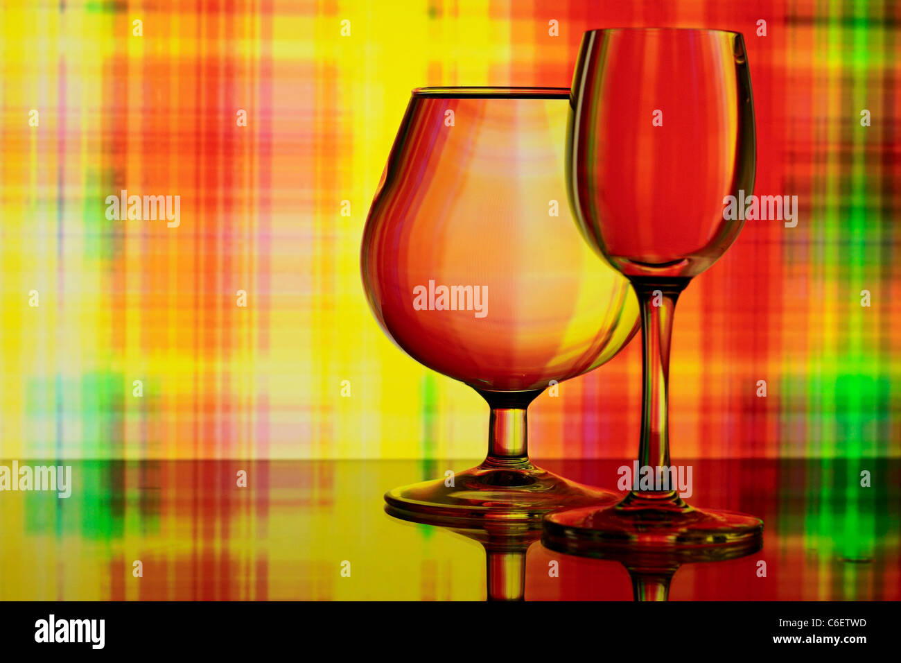 Two glasses on colorful abstract background Stock Photo