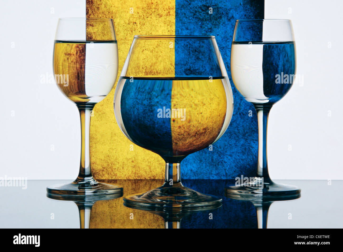 Still life - Glasses on colorful yellow and blue background Stock Photo