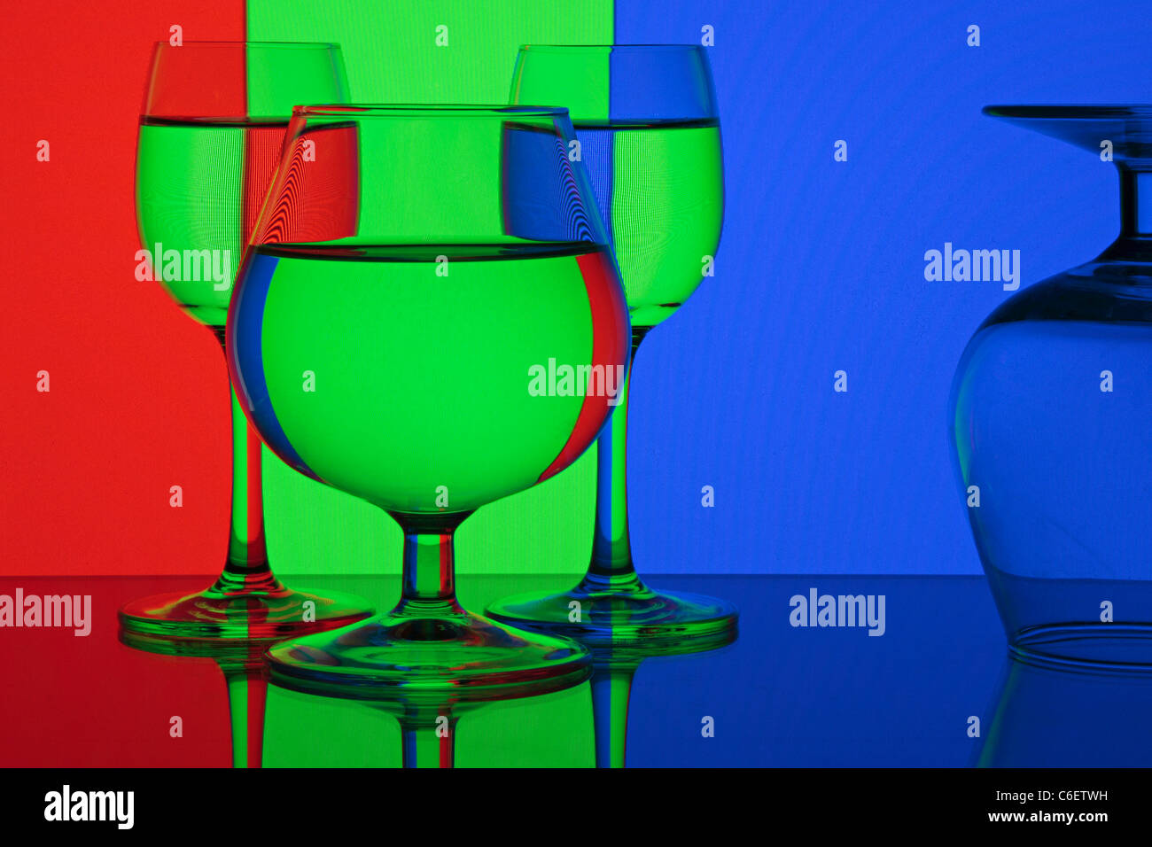 Abstraction - red, green, blue. Glasses on colorful background. Stock Photo