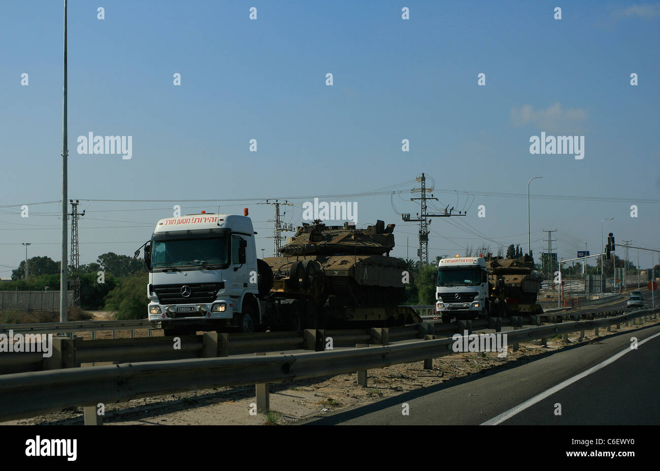 Shipment of main battle tanks taking part of the Israel Defense forces seen on the highway near Ashqelon, Israel. - Stock Image