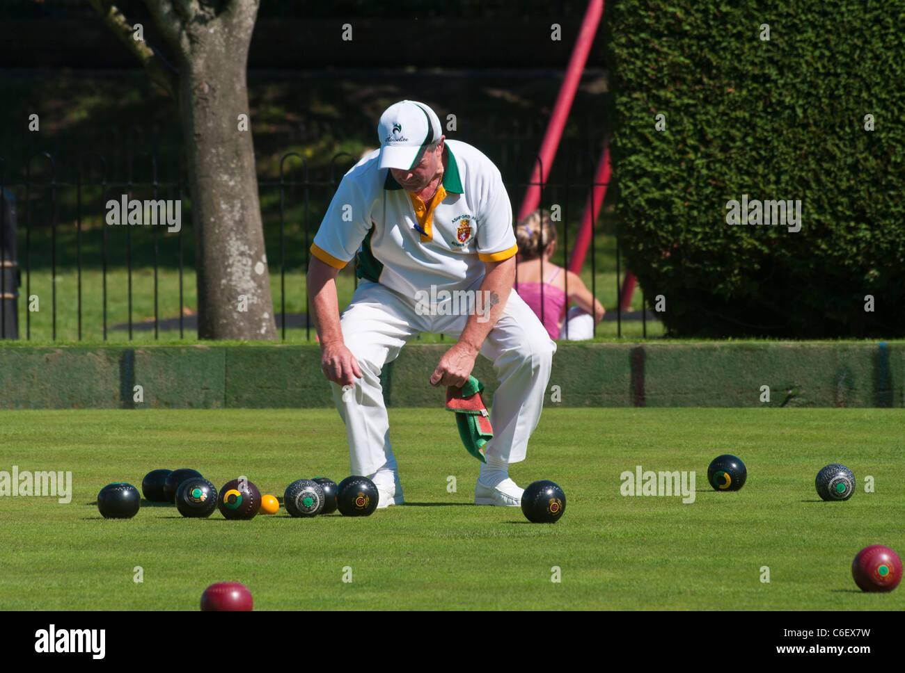 Man Playing Lawn Bowls - Stock Image