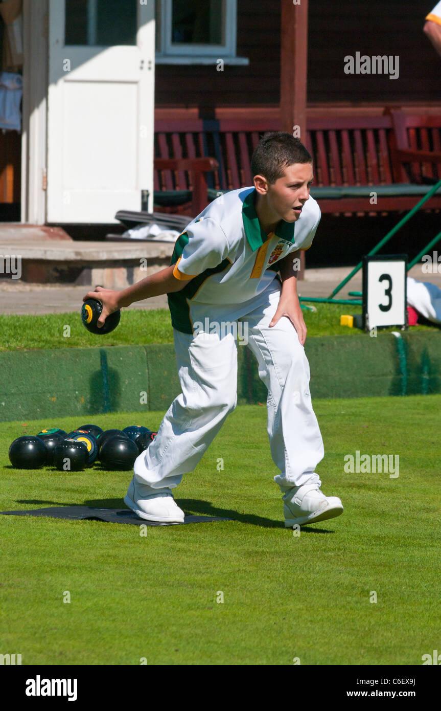 Teenager Playing Lawn Bowls - Stock Image